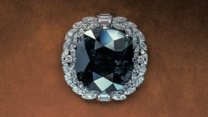The 67.50 ct Black Orloff diamond brooch set in platinum surrounded by diamonds.