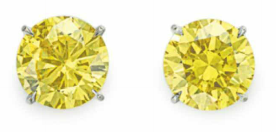3.01 carat and 3.01 carat Fancy Vivid Yellow diamond earrings