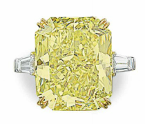 30.48 carat Fancy Vivid Yellow VS2 rectangular shaped diamond ring