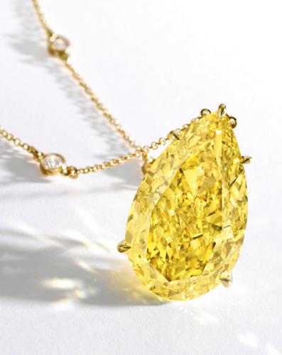 30.81 carat Fancy Vivid Yellow VS2 clarity pear shaped diamond necklace
