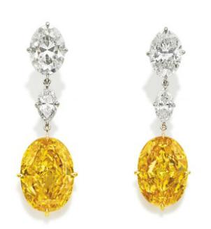 the Fancy Vivid Orange Yellow 'Oriental Sunrise' diamond earrings
