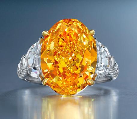 6.94 carat Fancy Vivid Yellowish Orange oval shaped diamond ring